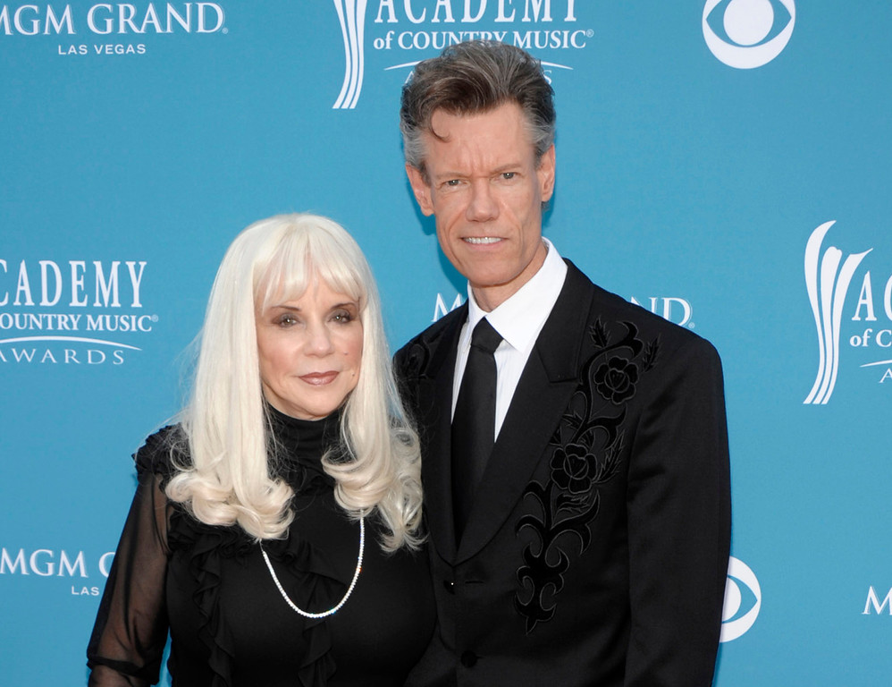 . FILE - In this April 18, 2010 file photo, country singer Randy Travis, right, and then wife Elizabeth arrive at the 45th Annual Academy of Country Music Awards in Las Vegas (AP Photo/Dan Steinberg, file)