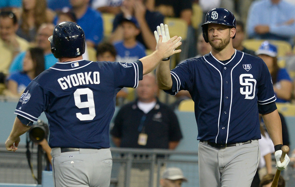 . Padres #9 Jedd Gyorko gets congratulated by Eric Stults after he crossed the plate in the 2nd inning. The Dodgers played the San Diego Padres at Dodger Stadium. Los Angeles, CA. 8/20/2014(Photo by John McCoy Daily News)
