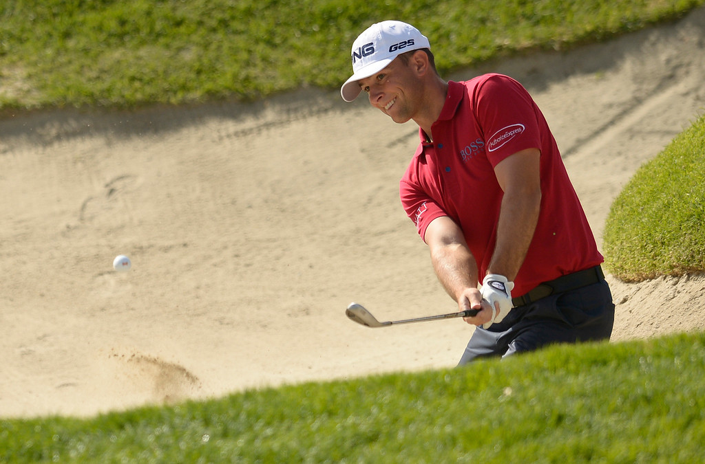 . Luke Guthrie hits out of the bunker on 2. Bubba Watson would become the eventual winner of the 2014 Northern Trust Open. Pacific Palisades, CA. February 16, 2014 (Photo by John McCoy / Los Angeles Daily News)