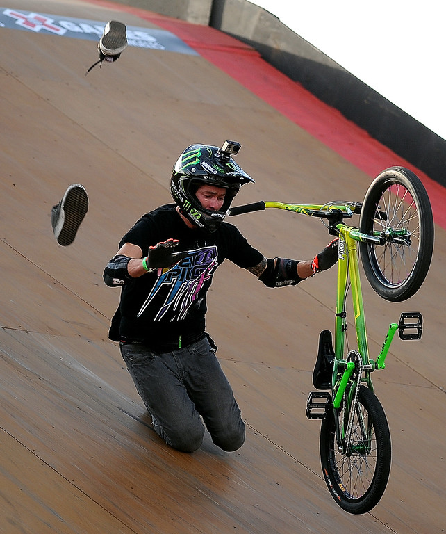 . Andy Buckworth loses his shoes as he crashes during the GoPro BMX Big Air Final at Irwindale Speedway on Friday, Aug. 2, 2013 in Irwindale, Calif. Morgan Wade won the gold medal.