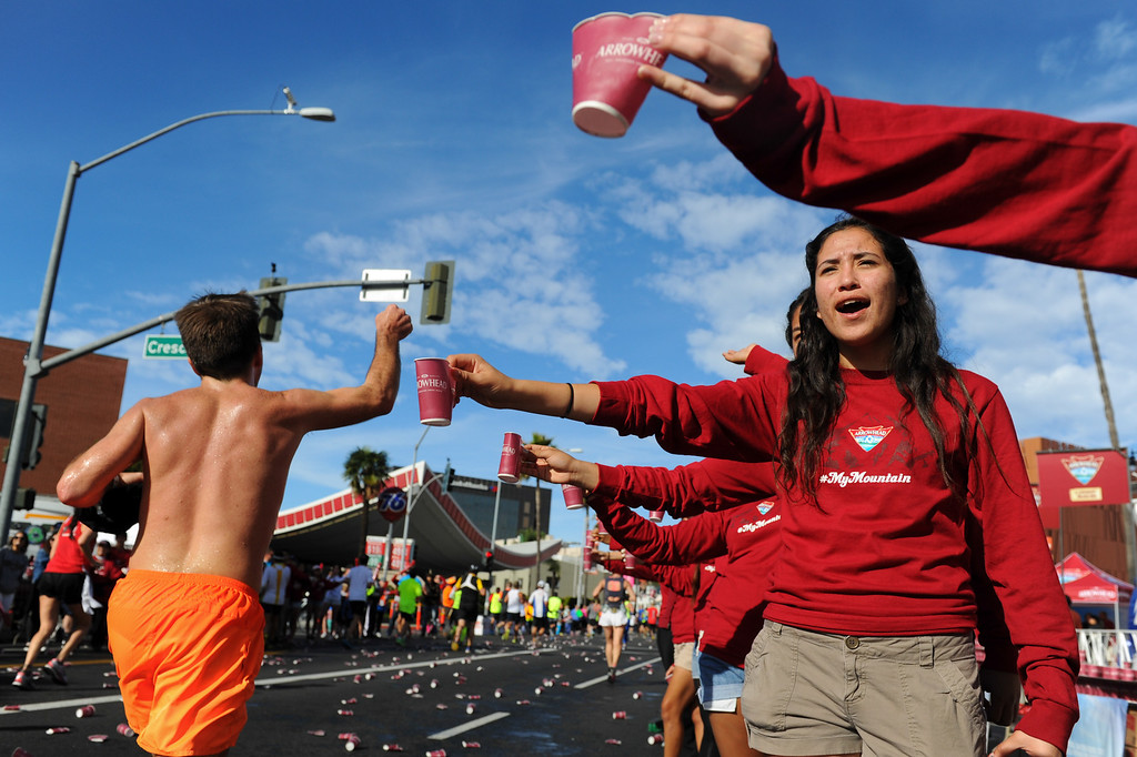 . Volunteers hand out water cups on Santa Monica Boulevard in Beverly Hills during the Los Angeles Marathon, Sunday, March 9, 2014. (Photo by Michael Owen Baker/L.A. Daily News)