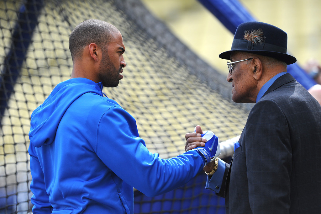 . Dodger Matt Kemp shakes hands with Dodger great Don Newcombe during batting practice at opening day, Friday, April 4, 2014, at Dodger Stadium. (Photo by Michael Owen Baker/L.A. Daily News)