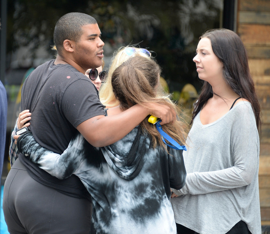 . May 24-,2014. Isla Vista, CA. Students comfort each other at one of the crime scenes after a drive-by shooter left seven people dead Friday night, including the attacker, and seven others wounded, authorities said Saturday.  The gunman got into two gun battles with deputies Friday night in the beachside community of Isla Vista before crashing his black BMW into a parked car. Photo by Gene Blevins/LA Daily News