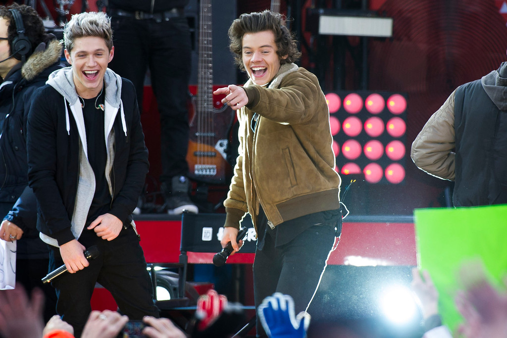 ". One Direction members, from left, Niall Horan and Harry Styles perform on ABC\'s ""Good Morning America\"" on Tuesday, Nov. 26, 2013 in New York. (Photo by Charles Sykes/Invision/AP)"