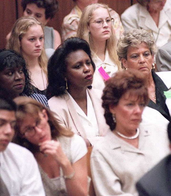 . Law professor Anita Hill (C) watches testimony in court during the O.J. Simpson murder trial in Los Angeles 05 July.  In front of Hill are Kim Goldman (L), the sister of victim Ronald Goldman, and his step-mother Patti Glass Goldman (R).    (POO/AFP/Getty Images)