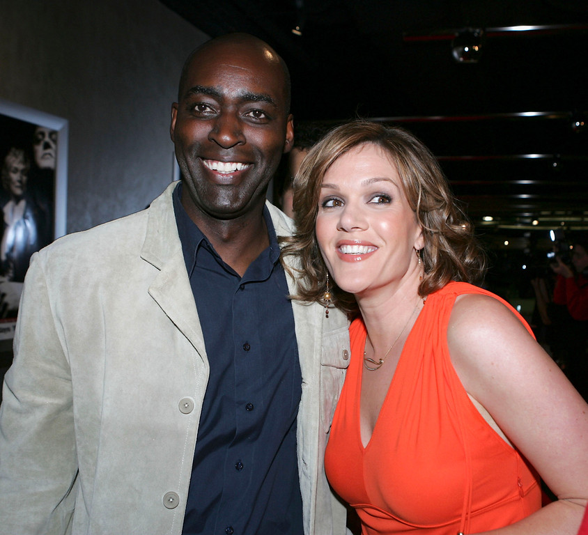""". Actors Michael Jace (L) and Catherine Dent pose at the 4th season premiere screening of FX\'s \""""The Shield\"""" at the Pacific Design Center on March 12, 2005 in West Hollywood, California. (Photo by Kevin Winter/Getty Images)"""