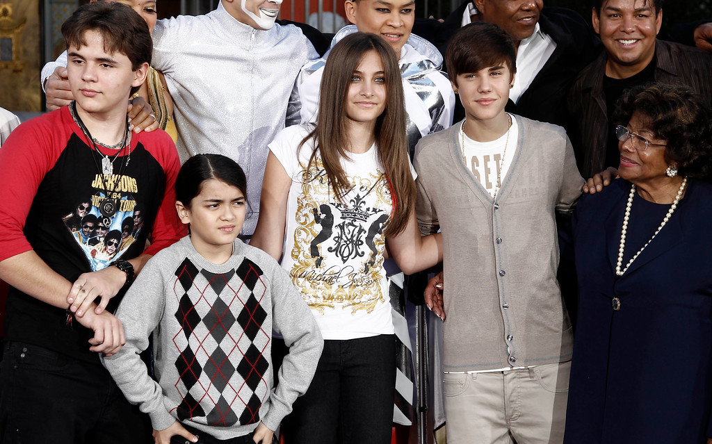 """. From left, Prince Jackson, Blanket Jackson, Paris Jackson, Justin Bieber, and Katherine Jackson pose together after the hand and footprint ceremony honoring musician Michael Jackson in front of Grauman\'s Chinese Theatre in Los Angeles, Thursday, Jan. 26, 2012. The ceremony was held to celebrate the \""""Michael Jackson The Immortal World Tour\"""" by Cirque du Soleil.  (AP Photo/Matt Sayles)"""