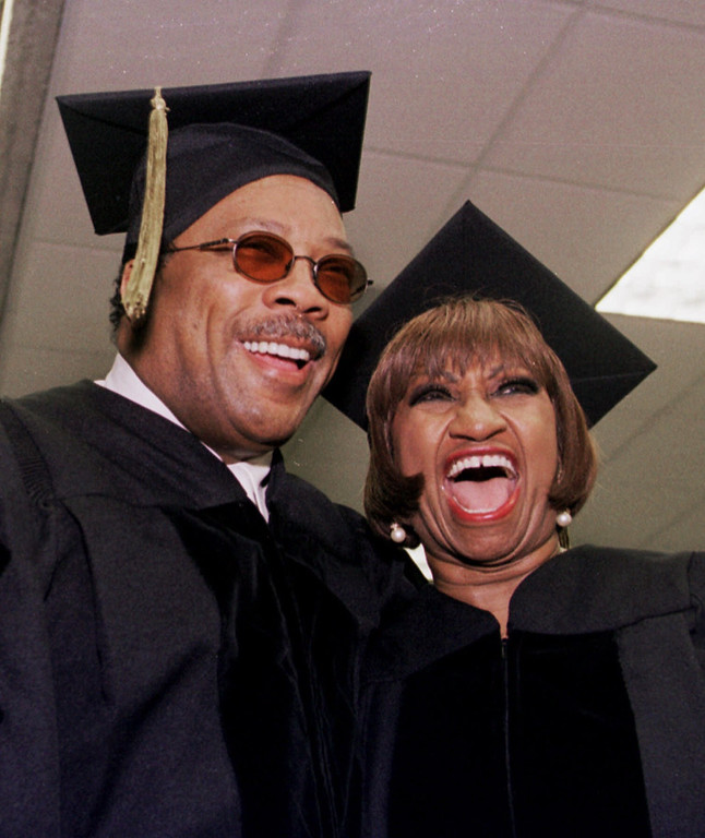 . Music impresario Quincy Jones, left, and salsa performer Celia Cruz, right, receive honorary degress Friday, May 14, 1999 at the University of Miami. Cruz and Jones received Doctor of Music degrees during the ceremony on campus in Coral Gables, Fla. (AP Photo/Alan Diaz)