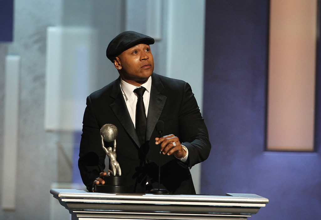 ". LL Cool J accepts the award for outstanding actor in a drama series for ""NCIS: Los Angeles\"" at the 44th Annual NAACP Image Awards at the Shrine Auditorium in Los Angeles on Friday, Feb. 1, 2013. (Photo by Matt Sayles/Invision/AP)"