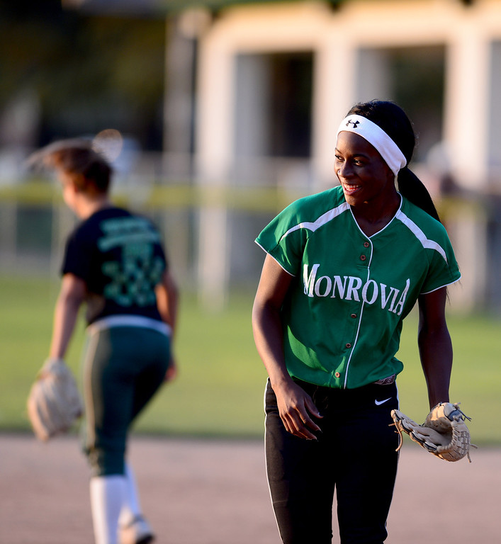 . Monrovia\'s Elise McCarthy (4) comes off the field during the West SGV softball all-star game Wednesday night, June 11, 2014 at Live Oak Park in Temple City. (Photo by Sarah Reingewirtz/Pasadena Star-News)