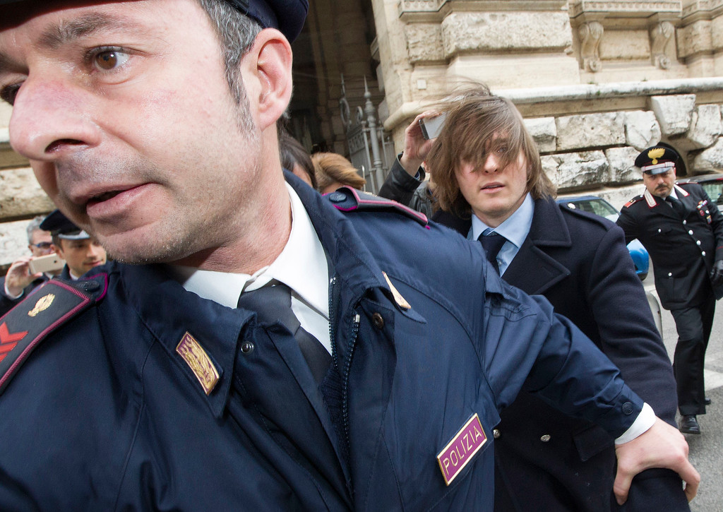 . Raffaele Sollecito, right, leaves Italy\'s highest court building, in Rome, Friday, March 27, 2015. American Amanda Knox and her Italian ex-boyfriend Sollecito expect to learn their fate Friday when Italy\'s highest court hears their appeal of their guilty verdicts in the brutal 2007 murder of Knox\'s British roommate Meredith Kercher. (AP Photo/Riccardo De Luca )