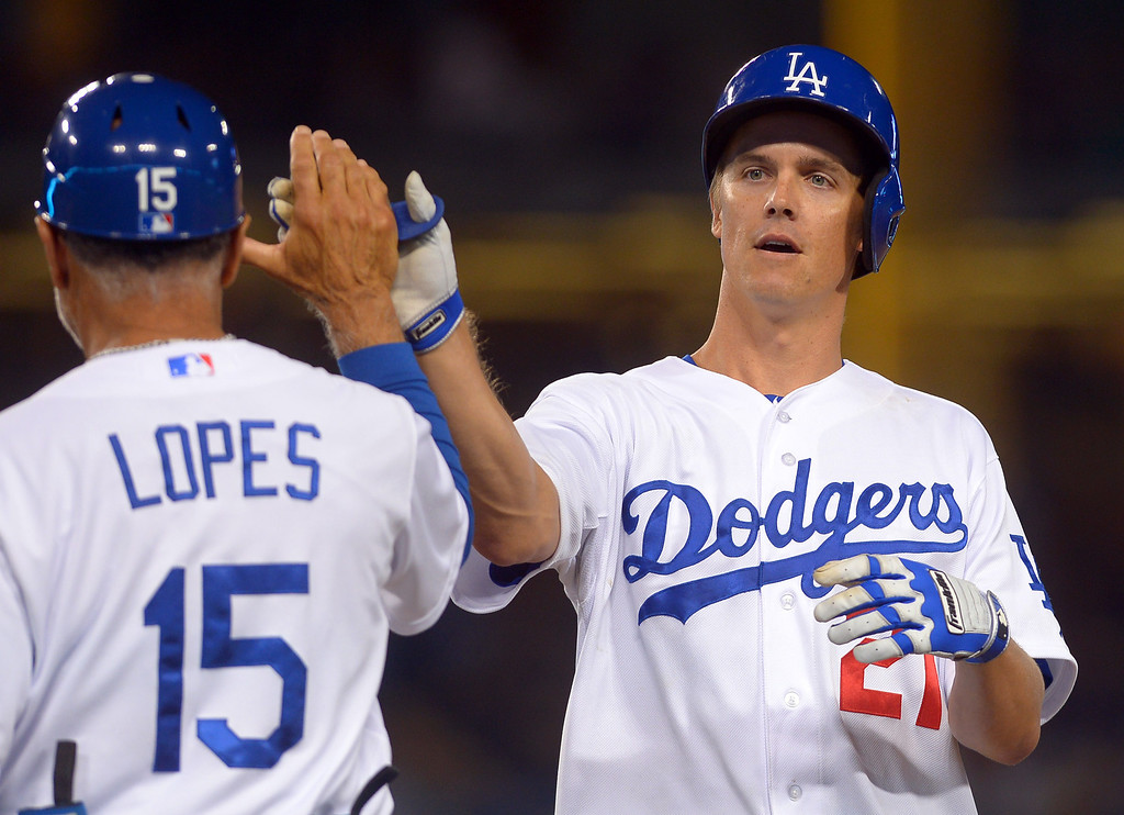 . Los Angeles Dodgers Zack Greinke is congratulated by first base coach Davey Lopes after knocking in a run in the 4th inning against the Chicago Cubs August 26, 2013 in Los Angeles, CA.(Andy Holzman/Los Angeles Daily News)