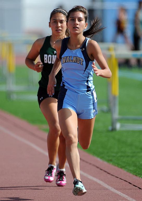 . Walnut\'s Jessica Gallardo, right, finishes ahead of Bonita\'s Kailyn Scott in the 1600 meter race during the Hacienda League track finals in Walnut, Calif., on Thursday, May 8, 2014.  (Keith Birmingham Pasadena Star-News)