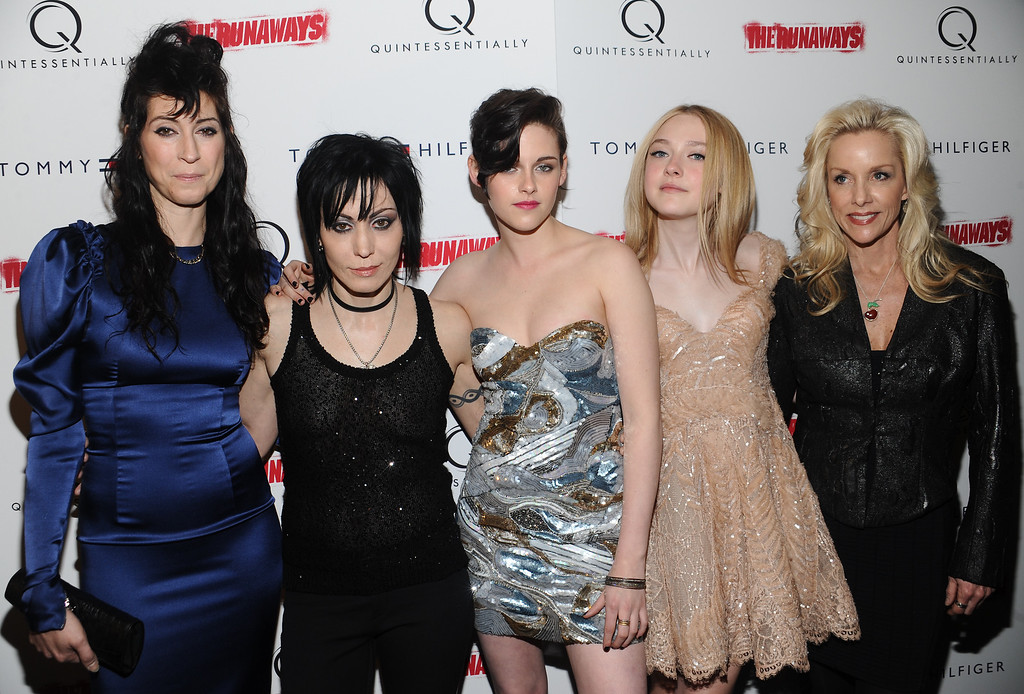 ". From left, writer - director Floria Sigismondi, musician Joan Jett, actress Kristen Stewart, Dakota Fanning and Cherie Currie attend a premiere for the film ""The Runaways\"" at the Landmark Sunshine Theater on Wednesday, March 17, 2010 in New York. (AP Photo/Evan Agostini)"