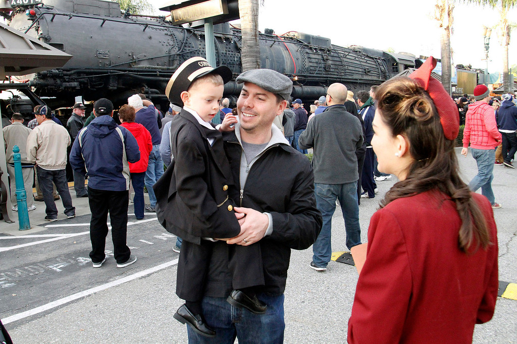 . Mike Roth of Monrovia, and his son Collin, 3, visit the historic Big Boy train, weighing 1,200,000 pounds, as it stopped at the Covina Metrolink Station for an hour on its way to Union Pacific\'s Heritage Fleet Operations headquarters in Cheyenne, Wyoming, at the Covina Metrolink Station in Covina, CA., Sunday, January 26, 2014. (Photo by James Carbone for the San Gabriel Valley Tribune)