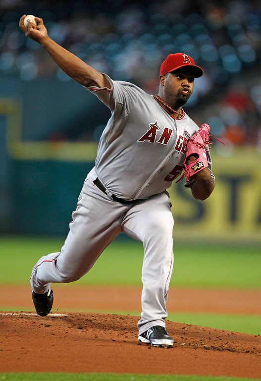 . Los Angeles Angels starter Jerome Williams delivers a pitch in the first inning of a baseball game against the Houston Astros Sunday, Sept. 15, 2013, at Minute Maid Park in Houston. (AP Photo/Eric Christian Smith)