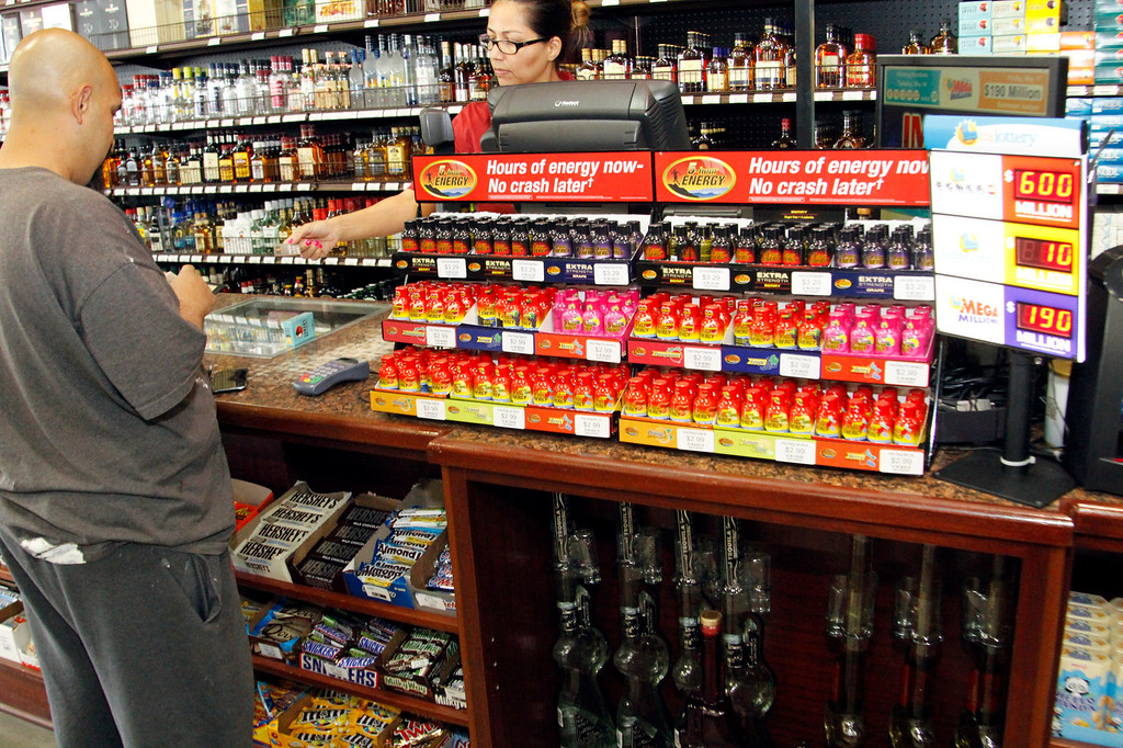 . Jeff Safady, of Pasadena, buys a Powerball ticket, a jackpot worth $600 milion, at Mission Liquor Store in Pasadena, Friday, May 17, 2013. (Correspondent Photo by James Carbone/SXCITY)