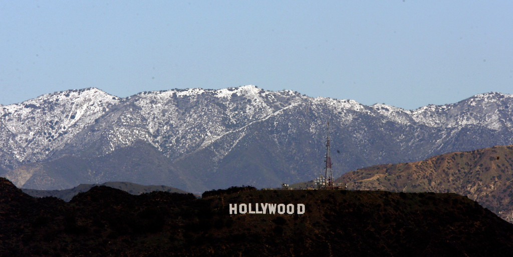 . The Hollywood sign in Los Angeles is seen Monday, Jan. 7, 2008, backed by snow-dusted mountains in the Angeles National Forest. The dusting of snow in the Southern California mountains was the result of a series of Pacific storms which moved south through the state over the weekend. (AP Photo/Nick Ut)