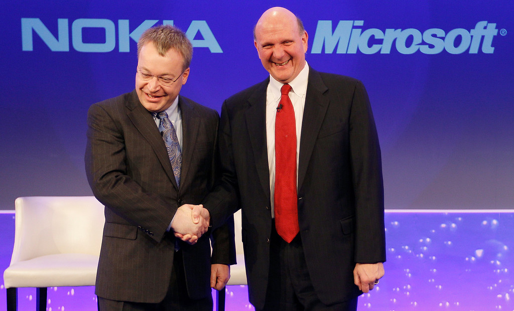 . Stephen Elop CEO of Nokia, left, shakes hands with CEO of Microsoft Steve Ballmer, in London, as they announce their strategic partnership, Friday, Feb. 11, 2011.   (AP Photo/Alastair Grant)