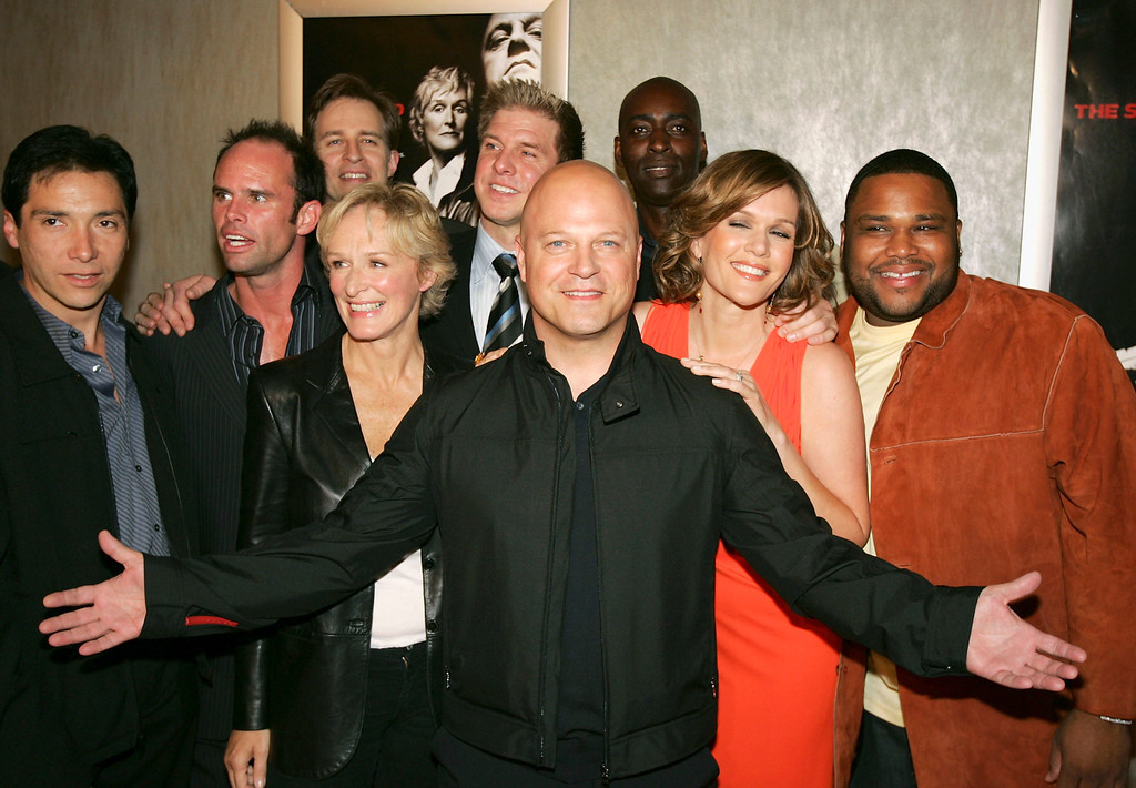 """. The cast of \""""The Shield\"""", with Michael Chiklis in front and (L-R) Benito Martinez, Walton Goggins, Jay Karnes, Glenn Close, Kenny Johnson, Michael Jace, Catherine Dent and Anthony Anderson pose at the 4th season premiere screening of FX\'s \""""The Shield\"""" at the Pacific Design Center on March 12, 2005 in West Hollywood, California. (Photo by Kevin Winter/Getty Images)"""