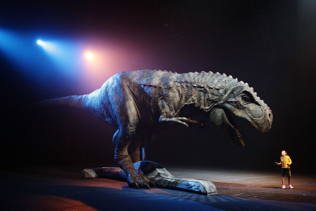 . SYDNEY, AUSTRALIA - OCTOBER 18:  at A Tyrannosaurus Rex dwarfs a small boy at the media call for Walking With Dinosaurs - The Arena Spectacular at The Entertainment Quarter on October 18, 2010 in Sydney, Australia. The arena show featuring life-sized dinosaurs returns to Australia after a successful world tour.  (Photo by Brendon Thorne/Getty Images)