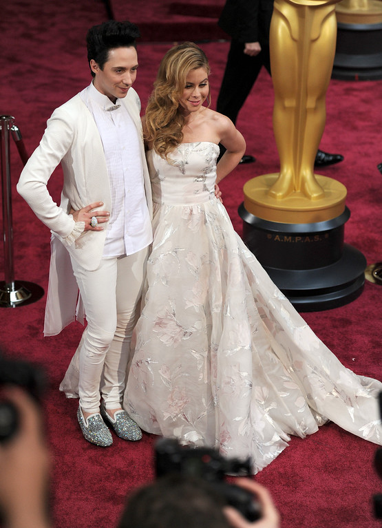 . Johnny Weir (L) and Tara Lipinski attend the 86th Academy Awards at the Dolby Theatre in Hollywood, California on Sunday March 2, 2014 (Photo by John McCoy / Los Angeles Daily News)
