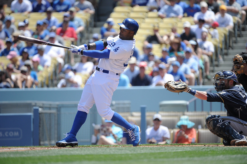 . Carl Crawford #25 of the Los Angeles Dodgers hits a homerun in the first inning against the Milwaukee Brewers at Dodger Stadium on April 28, 2013 in Los Angeles, California. Dodgers won 2-0.   (Photo by Lisa Blumenfeld/Getty Images)