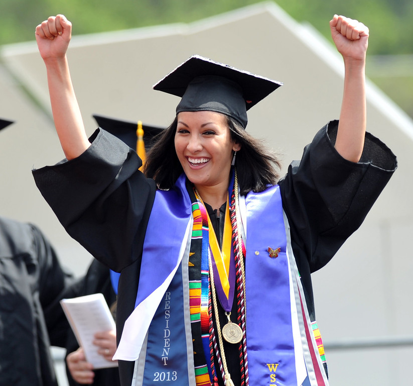 . Brianne Kamaladin cheers as her name is announced during the 110th Commencement Ceremony at Memorial Stadium on the Whittier College campus in Whittier on Friday May 17, 2013. Award-winning journalist Sonia Nazario gave the keynote address and received an honorary degree from the Whittier College faculty: a doctorate of humane letters.(SGVN/Staff Photo by Keith Durflinger)