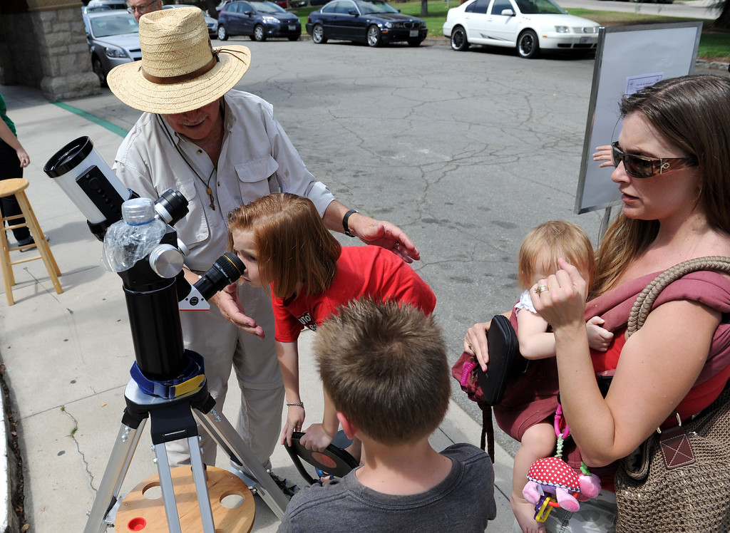 . (John Valenzuela/Staff Photographer) Jim Sommer, a member of the San Bernardino Valley Amateur Astronomers, brought his Lunt 60MM Solar Telescope to the the A.K. Smiley Library  to let people �safely� view the sun, in Redlands Thursday, August 29, 2013.