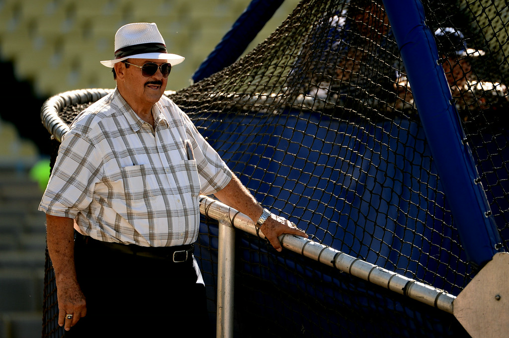 . Former Los Angeles Dodgers scout Mike Brito, right, looks on during batting practice prior to a Major league baseball game against the San Diego Padres on Saturday, July 12, 2014 in Los Angeles.   (Keith Birmingham/Pasadena Star-News)
