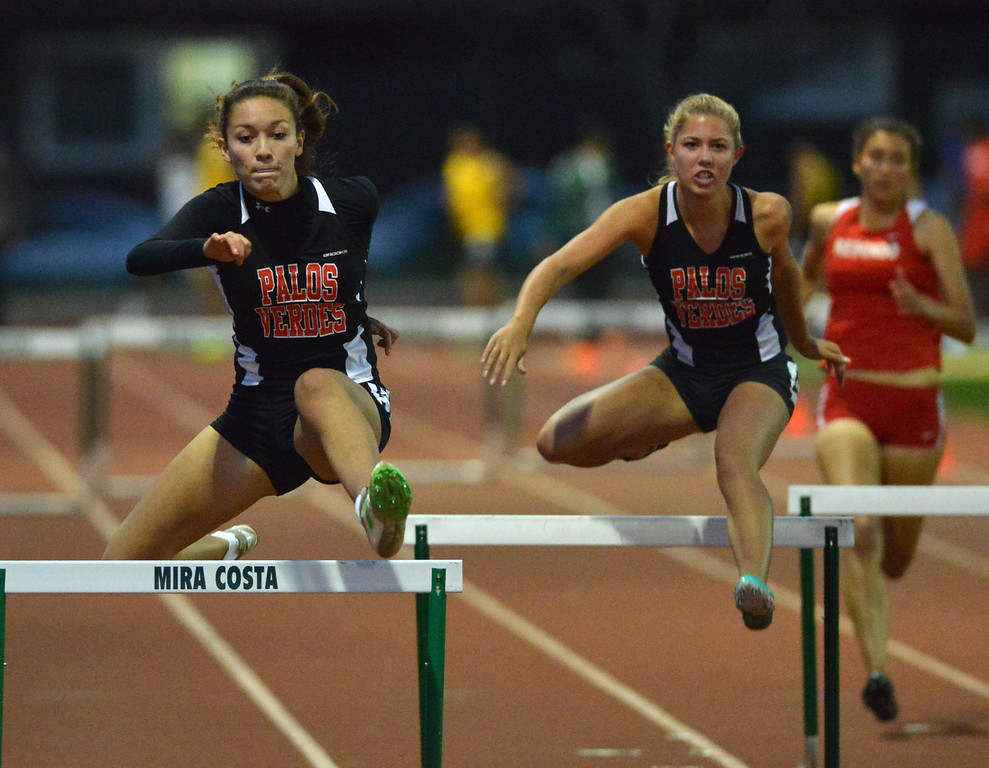 . 05-03-2013-(LANG Staff Photo by Sean Hiller)-  The Bay League track and field finals Friday night at Mira Costa High School. Palos Verdes\' Maile Davis,left, and Avery Durko in the girls varsity 300 meter hurdles.