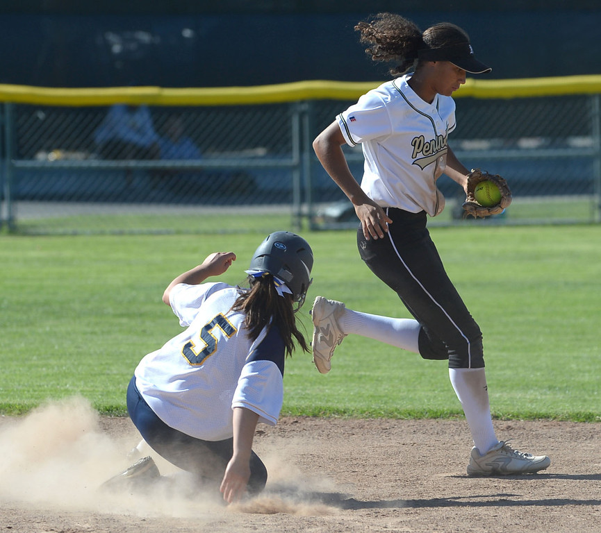 . Peninsula shortstop Brooke Vines (4) avoids a collision after making an out on Arroyo Grande\'s Ramie Castilleja (5) at second in a CIF Southern Section Division III wild-card softball game in Rolling Hills Estates Tuesday. Peninsula won the game 13-0. 20130514 Photo by Steve McCrank / Staff Photographer