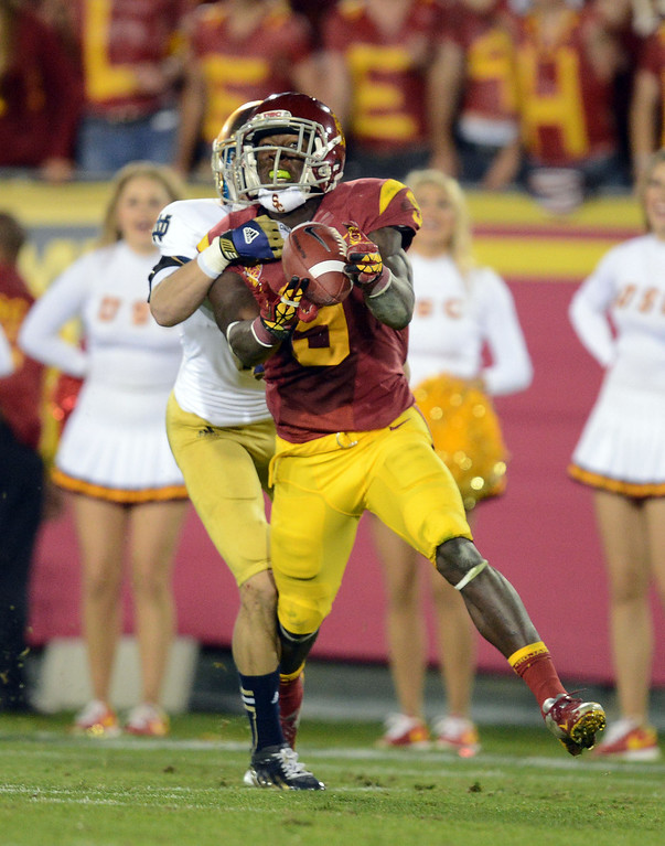 . USC\'s Marqise Lee (9) hauls in a long pass in the 4th quarter during their game against Notre Dame at the Los Angeles Memorial Coliseum Saturday, November 24, 2012. (Hans Gutknecht/L.A. Daily News)