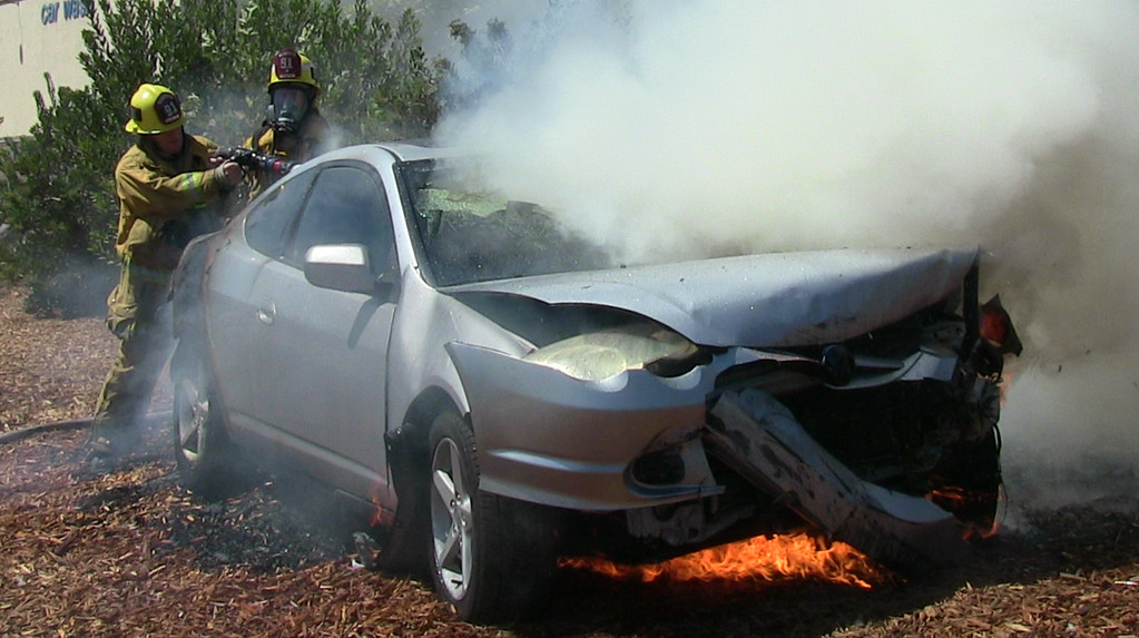 . Aug 31,2014, Sylmar CA. LA city fire work quick to put out a car fire after a it was involved in a crash on the 210 freeway and came off the freeway at at Roxford. The driver suffered minor burns after the crash and was not transported to the hospital. Photo by Gene Blevins/LA DailyNews