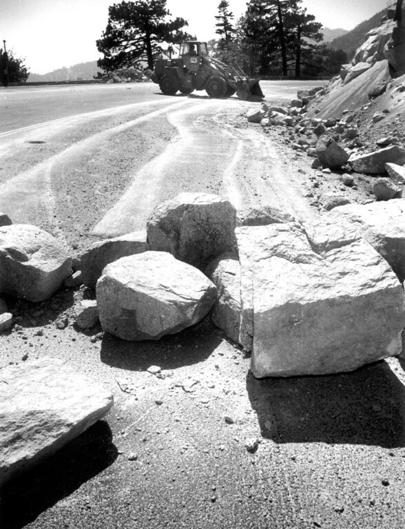 . June 28, 1992: A Caltrans skiploader clears boulders and rocks Sunday off Highway 18 leading into Big Bear.  Daily News file photo