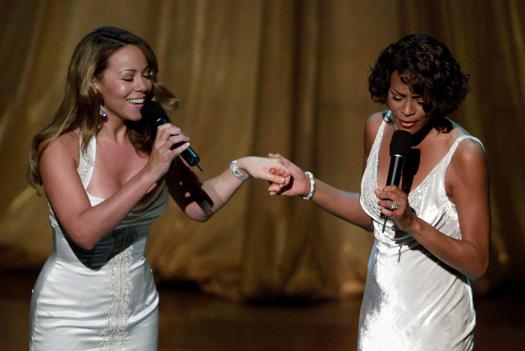 """. Mariah Carey, left, and Whitney Houston perform their Oscar-nominated song, \""""When You Believe\"""" from the movie \""""The Prince of Egypt,\"""" during the 71st Annual Academy Awards at the Dorothy Chandler Pavilion of the Los Angeles Music Center Sunday, March 21, 1999. (AP Photo/Eric Draper)"""