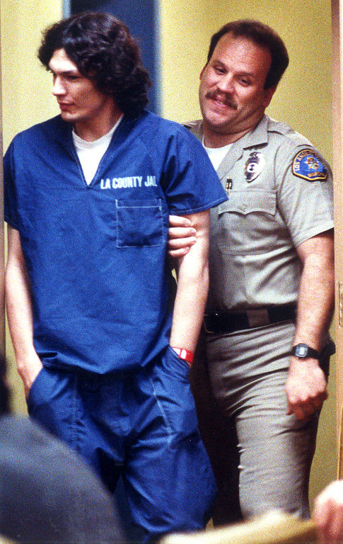 . Night Stalker suspect Richard Ramirez and a bailiff react to the media as the two return to court after lunch.  (Daily News file photo)