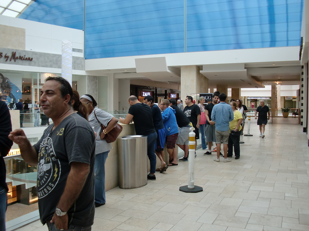 . The line was quiet, the wait an hour, on the morning of Sept. 20, 2013, outside the Apple Store at the Westfield Topanga mall in Woodland Hills. The story was open from 8 a.m. to 9 p.m. for the first day of sales for the iPhone 5c and 5s. (Photo by Steven Rosenberg/Los Angeles Daily News)