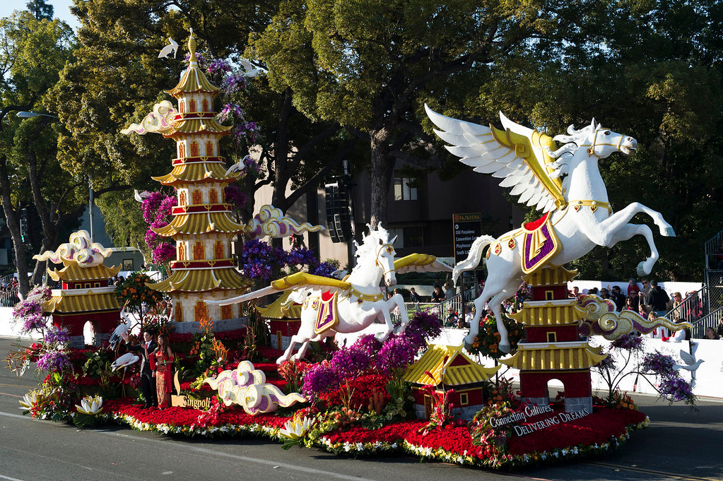 ". Singpoli Group ""Connecting Cultures, Delivering Dreams\"" float during 2014 Rose Parade in Pasadena, Calif. on January 1, 2014. This float won Extraordinaire Award for most spectacular float. (Staff photo by Leo Jarzomb/ Pasadena Star-News)"