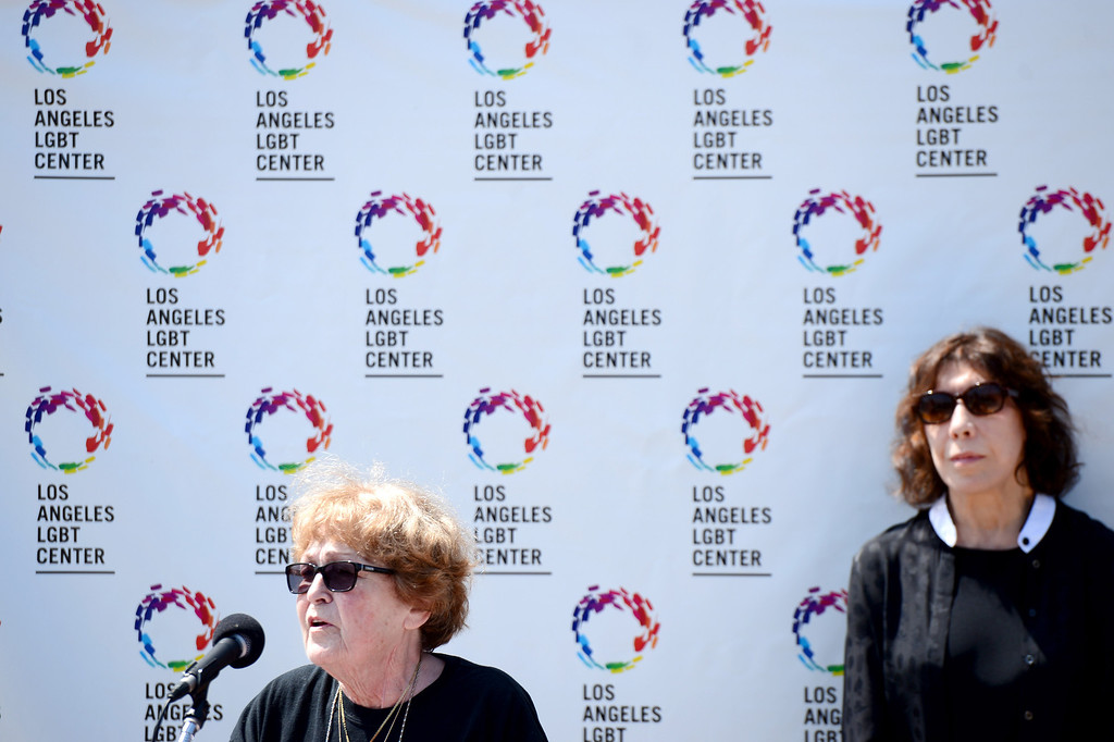 . With comedian Lily Tomlin by her side Alice Herman, 78, a resident of Triangle Square, an LGBT complex for seniors, speaks about her experience being a client of the Los Angeles LGBT Center as the center announces a $25 million campaign to develop an affordable housing campus for LGBT youth and seniors Tuesday, May 27, 2014. Around 40 percent of the more than 6,000 homeless youth in Los Angeles identify as lesbian, gay, bisexual or transgender and the city has 65,000 LGBT seniors according to the L.A. Gay & Lesbian Center. The center has raised $19 million. (Photo by Sarah Reingewirtz/Pasadena Star-News)
