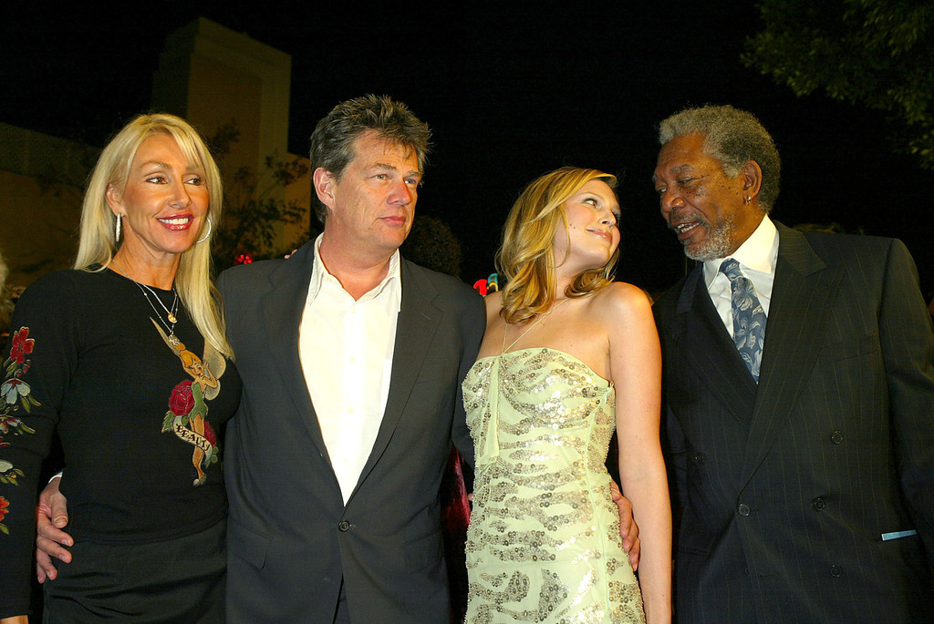 """. WESTWOOD, CA  - JANUARY 29:  (L to R) Songwriters Linda and David Foster, his daughter actress Sara Foster and actor Morgan Freeman arrive at the Los Angeles premiere of Warner Bros. \""""The Big Bounce\"""" at the Mann\'s Village on January 29, 2004 in Westwood, California. (Photo by Kevin Winter/Getty Images)."""