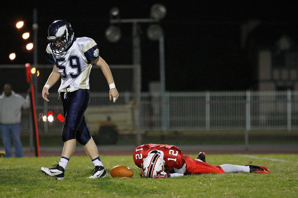 . Quarterback Chris Murray #12 of Lawndale reacts after losing his balance and failing to covert on fourth down against the defense of El Segundo in a Pioneer League matchup at Leuzinger High School on Friday, October 11, 2013 in Lawndale, Calif.  (Michael Yanow / For the Daily Breeze)