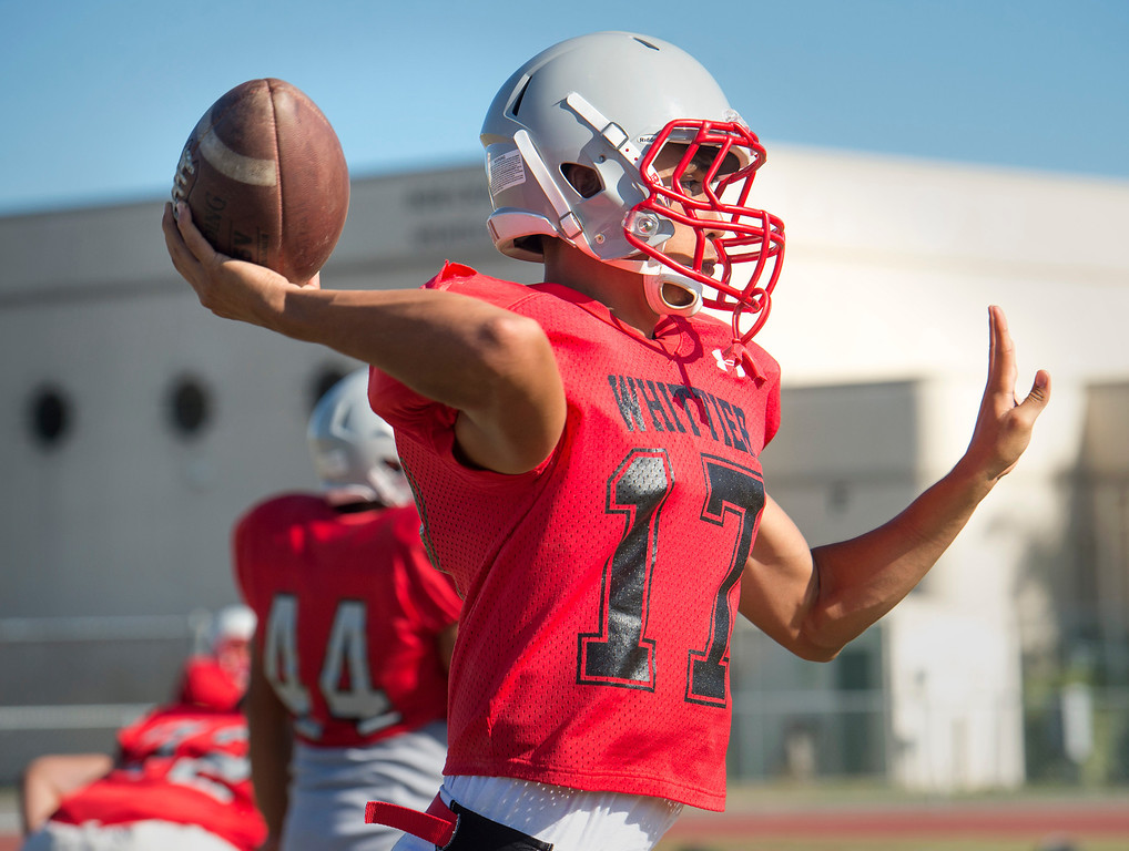 . Whittier High QB Jared Reza passes during preseason football practice August 27, 2013.   (SGVN/Staff photo by Leo Jarzomb)