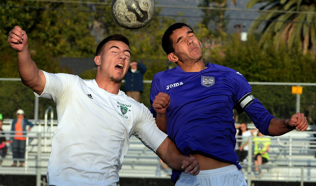 . Monrovia\'s Danny Hoefferle, left, with the header past Diamond Bar\'s Spenser Brose (C) in the second over-time during a second round soccer match at Monrovia High School in Monrovia, Calif., on Tuesday, Feb.25, 2014. Diamond Bar won 3-2 on penalty kicks. (Keith Birmingham Pasadena Star-News)