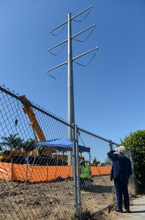 . A resident watches as Southern California Edison begins the process of dismantling the Tehachapi towers in Chino Hills, CA Wednesday, September 25, 2013. (Staff photo/Inland Valley Daily Bulletin)