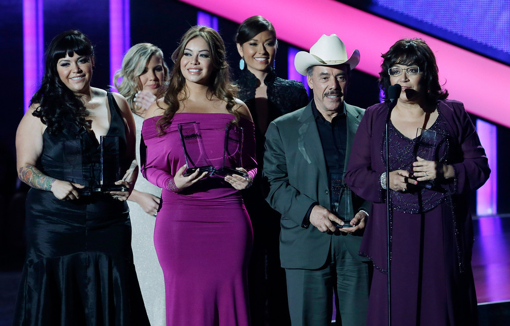 . The family of singer Jenni Rivera receives six awards including artist of the year at the Latin Billboard Awards in Coral Gables, Fla., Thursday April 25, 2013. Rivera perished in a plane crash last year. (AP Photo/Alan Diaz)