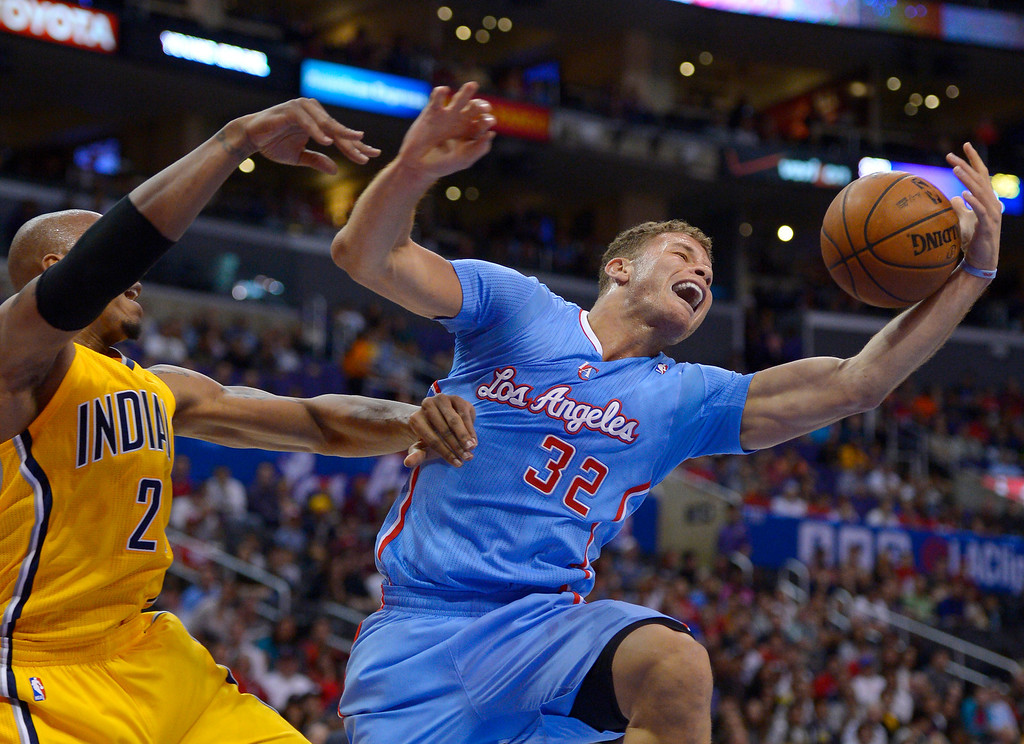 . Los Angeles Clippers forward Blake Griffin, right, takes a rebound away from Indiana Pacers forward David West during the first half of an NBA basketball game, Sunday, Dec. 1, 2013, in Los Angeles. (AP Photo/Mark J. Terrill)