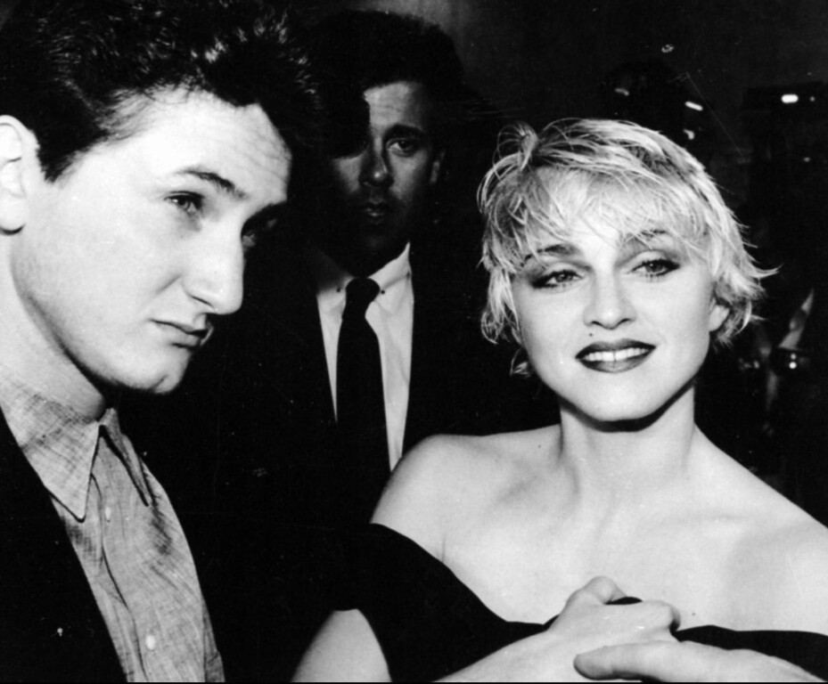 ". Sean Penn and his wife, singer Madonna, stop April 17, 1986 to chat with reporters prior to the screening of Penn\'s new movie ""At Close Range\"" in Los Angeles. (AP photo/Craig Mathew)"