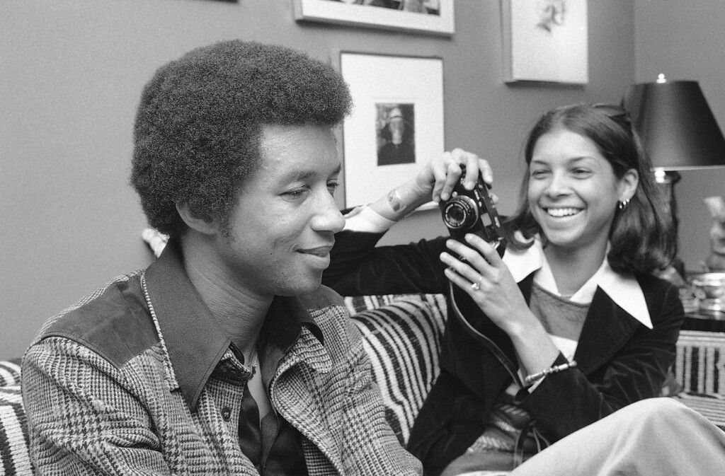 . Tennis star Arthur Ashe with his wife Jeanne in New York on Feb. 16, 1977. (AP Photo/Carlos Rene Perez)
