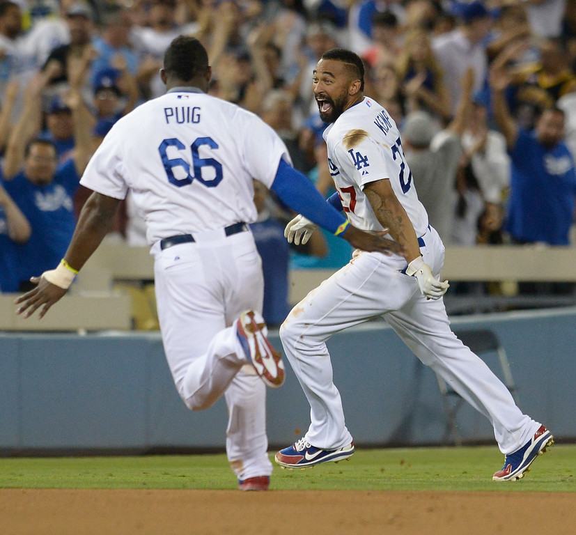 . Matt Kemp reacts to his game winning single that scored Justin Turner in the 10th inning. The Dodgers defeated the Atlanta Braves 3-2 in a game played at Dodger Stadium in Los Angeles, CA. 7/30/2014(Photo by John McCoy Daily News)